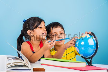 stock-photo-indian-boy-and-girl-studying-with-globe-on-study-table-asian-kids-studying-indian-kids-studying-411808453